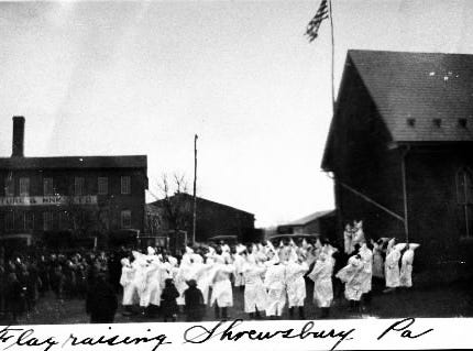 The Klan has long cloaked its message of hate in the American flag. Here we have  a Klan flagraising in Shrewsbury, in southern York County, in this undated photo. So the Klan comes and goes, but unfortunately they never quite goes way.  In August 2018, they're back again in York County with recruitment fliers.