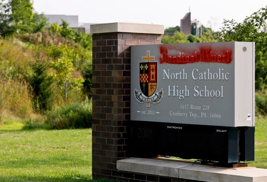 Paint covers the name of Cardinal Wuerl at Cardinal Wuerl North Catholic High School, on Monday, Aug. 20, 2018, in Cranberry Township, Pa. Wuerl, a Roman Catholic Cardinal, and the archbishop of Washington, D.C., has come under fire from revelations in the Pennsylvania grand jury report about his actions while bishop of Pittsburgh.