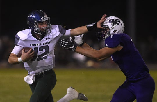 Damonte Ranch's Cade McNamara (12) runs free while taking on Spanish Springs during their football game at Spanish Springs on Sept. 15, 2017.