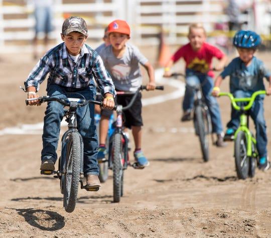 Boys race in the BMX bike race.