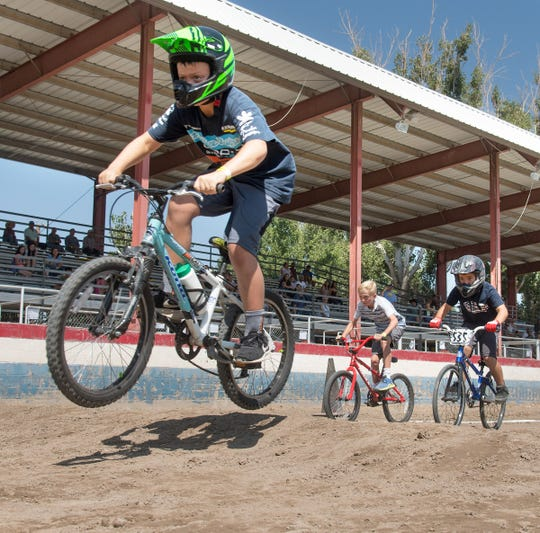 A racer gets airborne during the boys' 8 to 9-year-old finals in the BMX race.