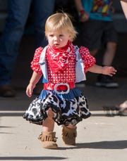 Paisley DeWitt, 1, of Yerington, is all dressed up for the Littlest Cowgirl contest.