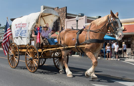 A covered wagon from the Lyon County Museum participates in the Mason Valley Chamber parade.