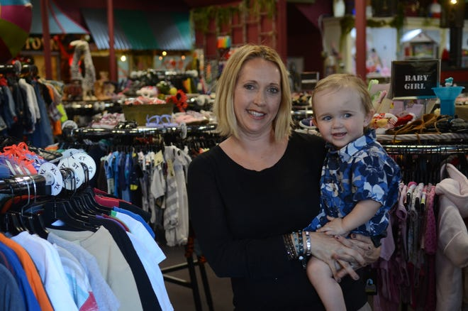 Terri Hull poses in August 2016 with her son, Lorne, in her Midtown Reno store, Sippee's. The children's clothing store is closing on Labor Day but will maintain an online and pop-up presence.