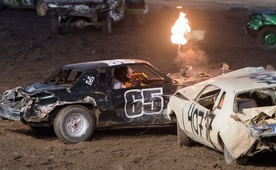 Flames shoot out of a car's exhaust pipe during one of the heats at the Destruction Derby.