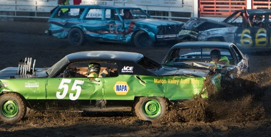 The Destruction Derby is one of the fair's most popular events, drawing a capacity crowd to the arena.