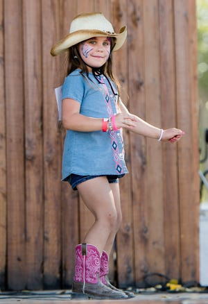 Paisley Starr, 8, of Fallon, dances on stage during the Littlest Cowgirl contest.