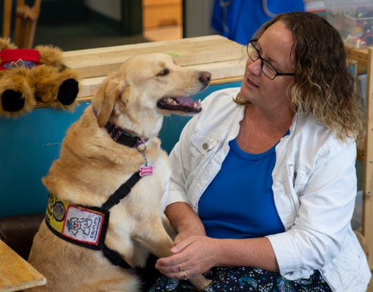 Shelby, a therapy dog, interacts with her owner, Kathy Campbell, in a preschool classroom at Ivy Tech Community College on Wednesday, Aug. 22, 2018.