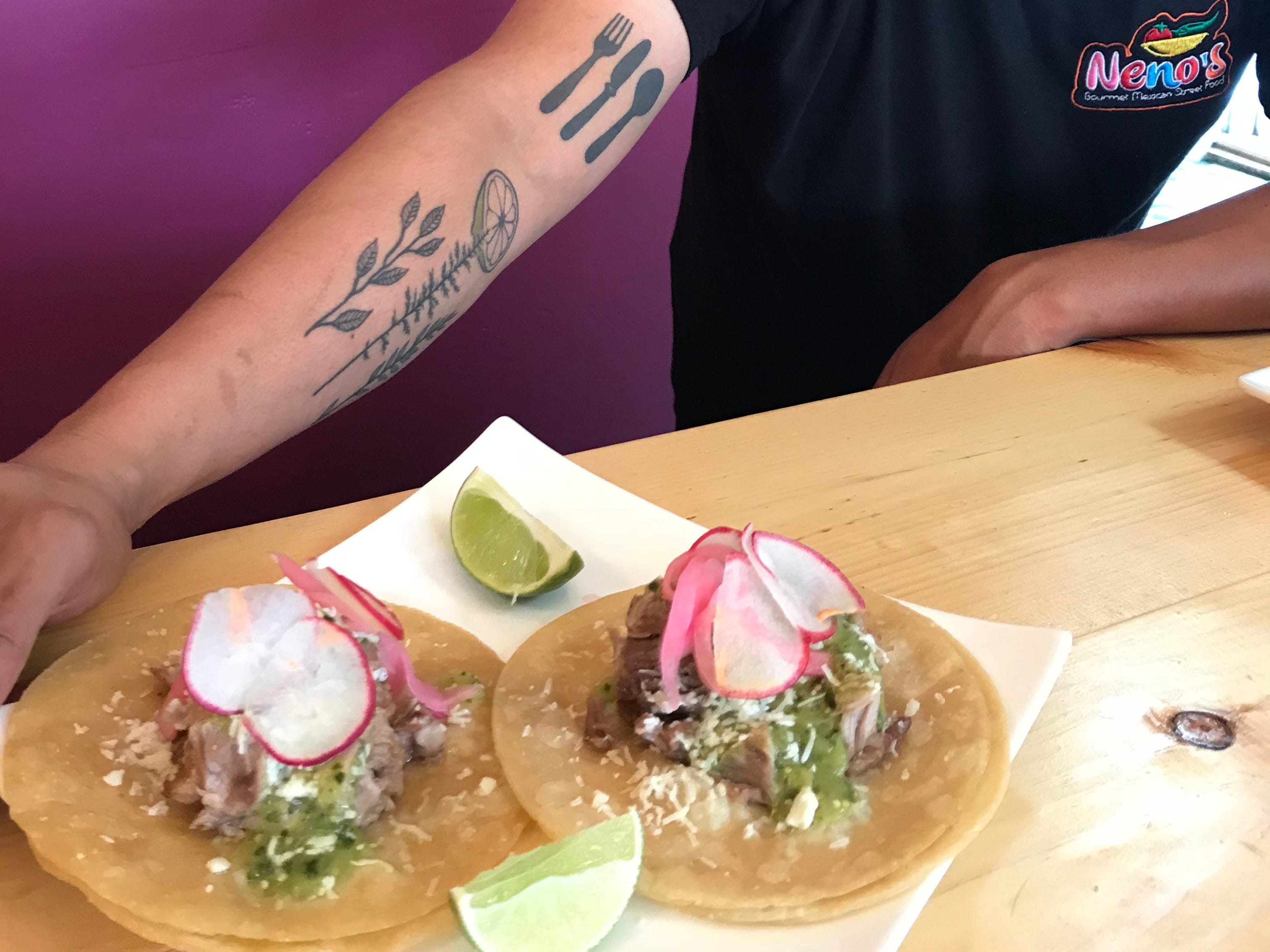 Fidelio Rita shows off his tatoos and his carnitas tacos.