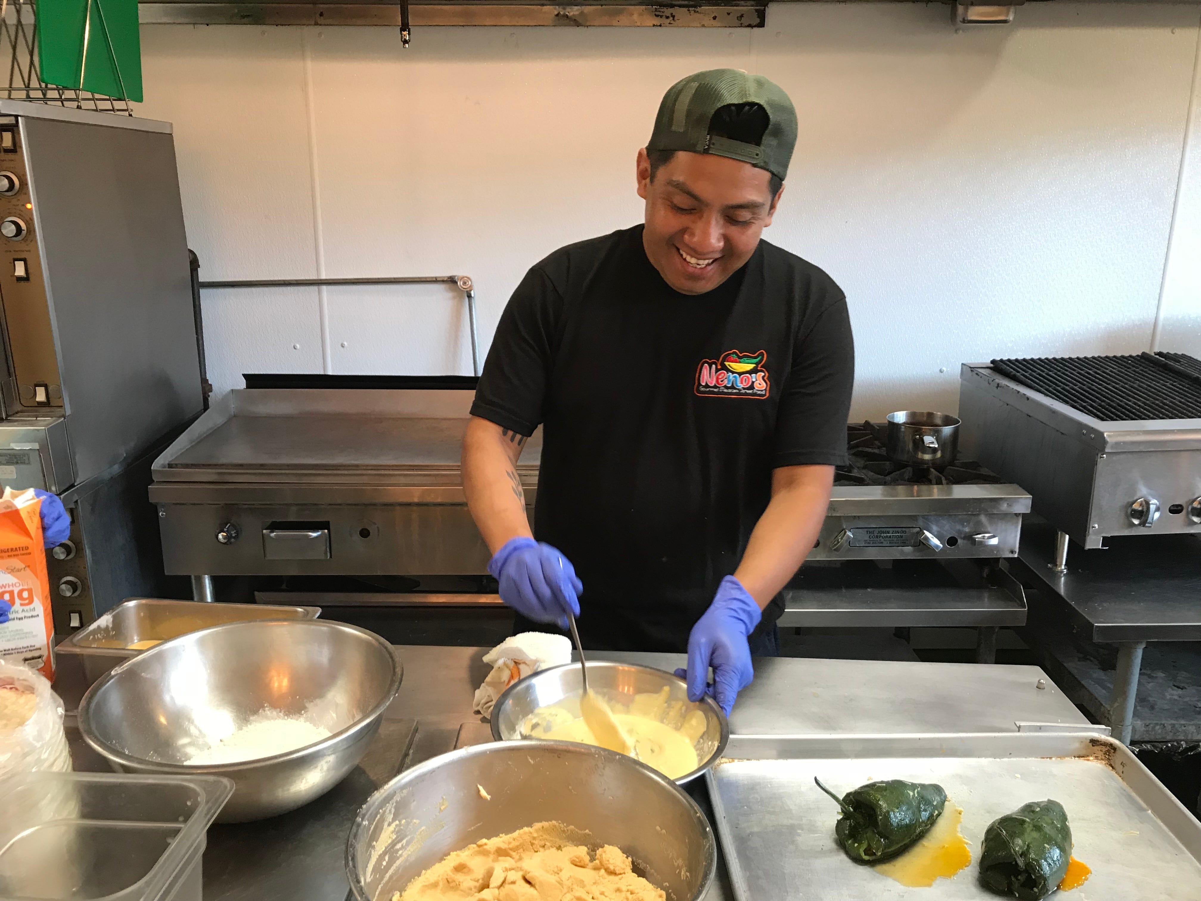 Fidelio Rita cooks at Neno's, 649 Monroe Ave.