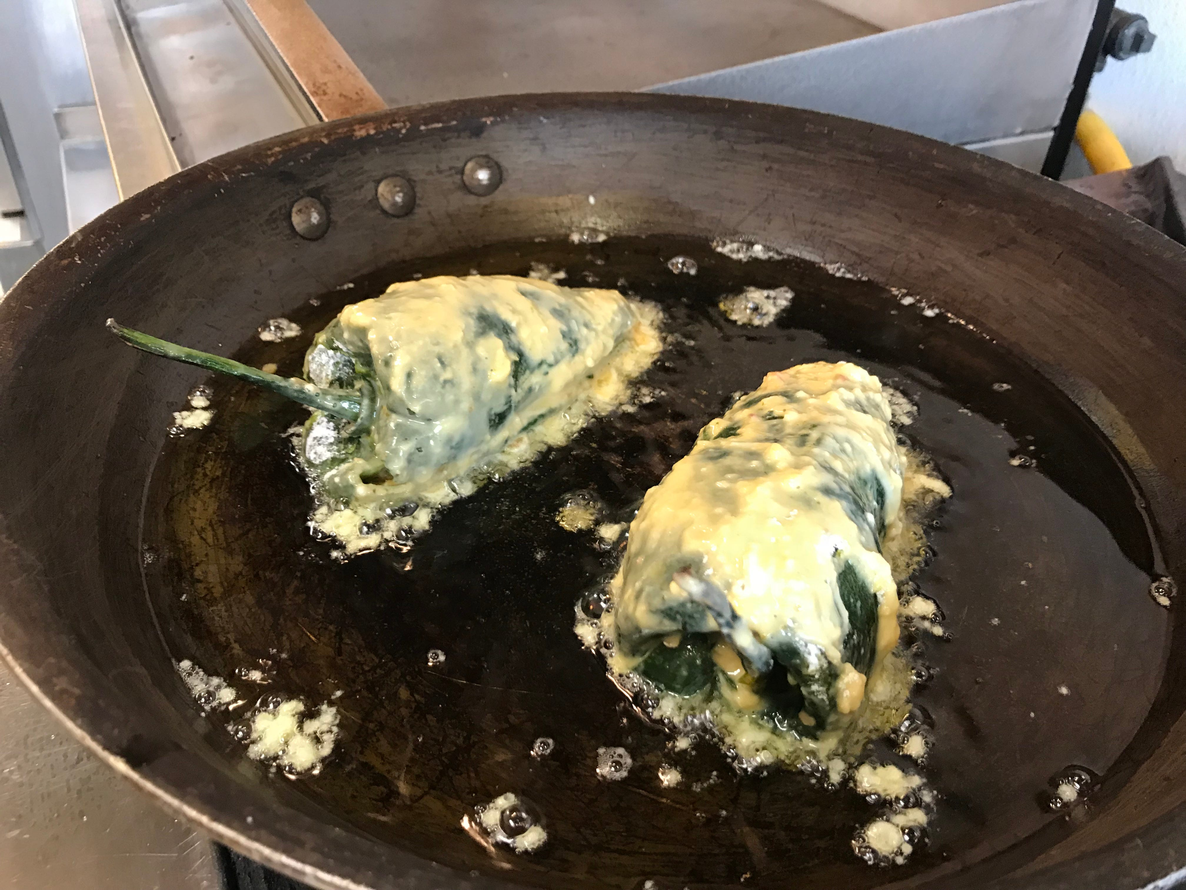 Chiles rellenos cook at Neno's.