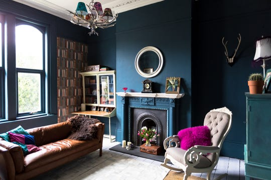 A bold, monochromatic paint color can add a dose of glamour to any room.