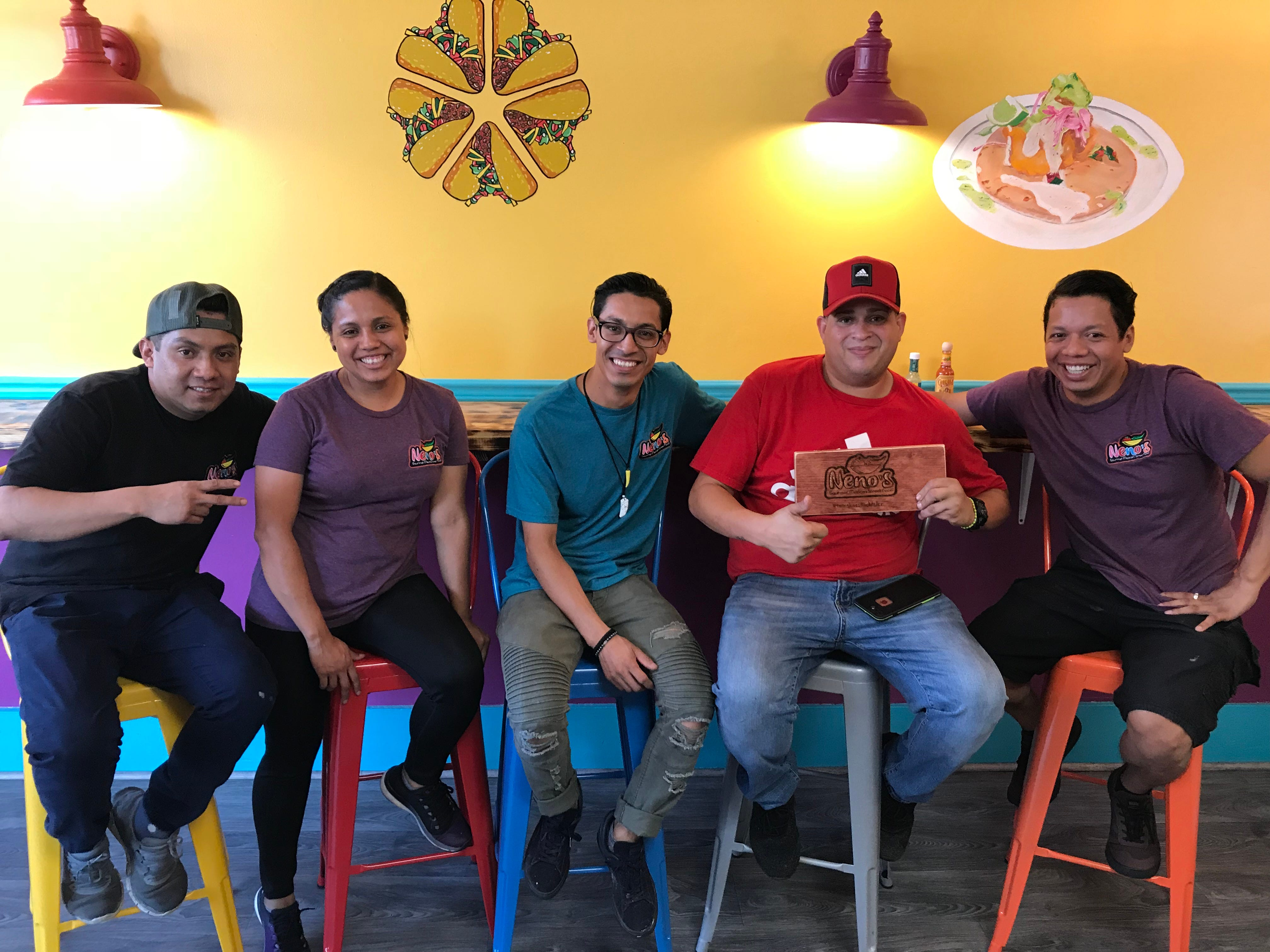 The Neno's crew includes siblings (from left, in Neno's T-shirts) Fidelio, Ojayra, Derlisrael and Eden Rita. Jorge Enrique Velázquez, in red, is sous chef.