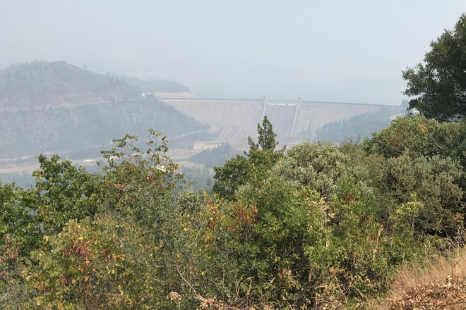 Smoke from the Carr and Hirz fires combine to form a haze over Shasta Dam and Lake Shasta on Sunday, Aug. 19.