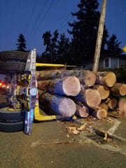 A rollover crash involving a log truck blocked the intersection at 1st and Shaff in Stayton Wednesday morning.