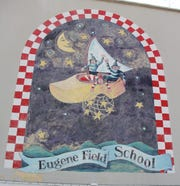 A mural on the side of Eugene Field School, which is being tabbed for demolition.