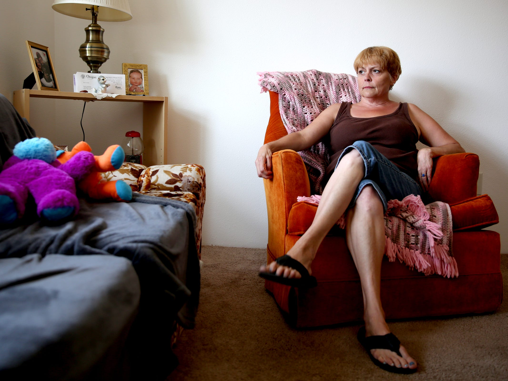 Kathie Dollarhide was homeless, living with mental and physical health concerns and had a history of drug and alcohol abuse before being accepted into the Homeless Rental Assistance Program through the Salem Housing Authority. Photographed in Dollarhide's West Salem apartment on Wednesday, Aug. 22, 2018.