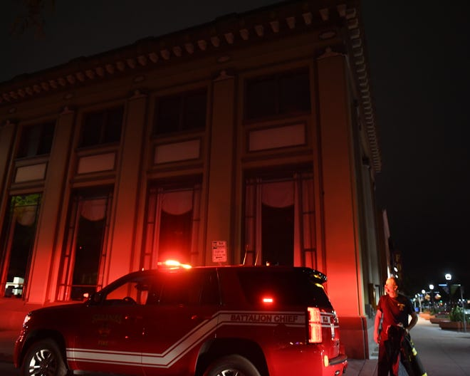Battalion Chief Scott Myhre looks at the building at 201 Main St., a restaurant where a fire broke out in the kitchen during repairs Tuesday evening.