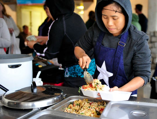 Sarinya Hendren serves Thai cuisine  during the  2015 Asian Bazaar hosted by The Association of Asian American Women.