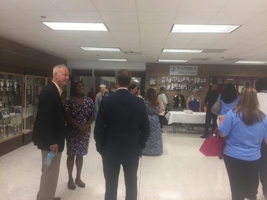 Del. Rob Bloxom, left, chats with Mike Tolbert, Accomack County Public Schools Chief of Management and Operations, and Keyanna Conner, Virginia Secretary of Administration, during a back-to-school celebration for Accomack County Public Schools employees at Nandua High School in Onley on Wednesday, Aug. 22, 2018.