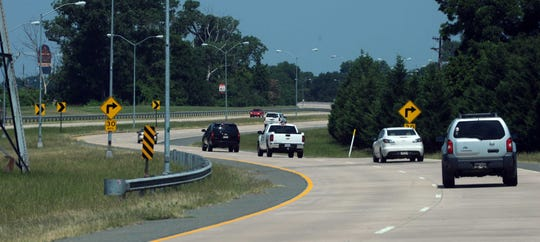 FILE: Traffic drives along the Arthur Ray Teague Parkway.