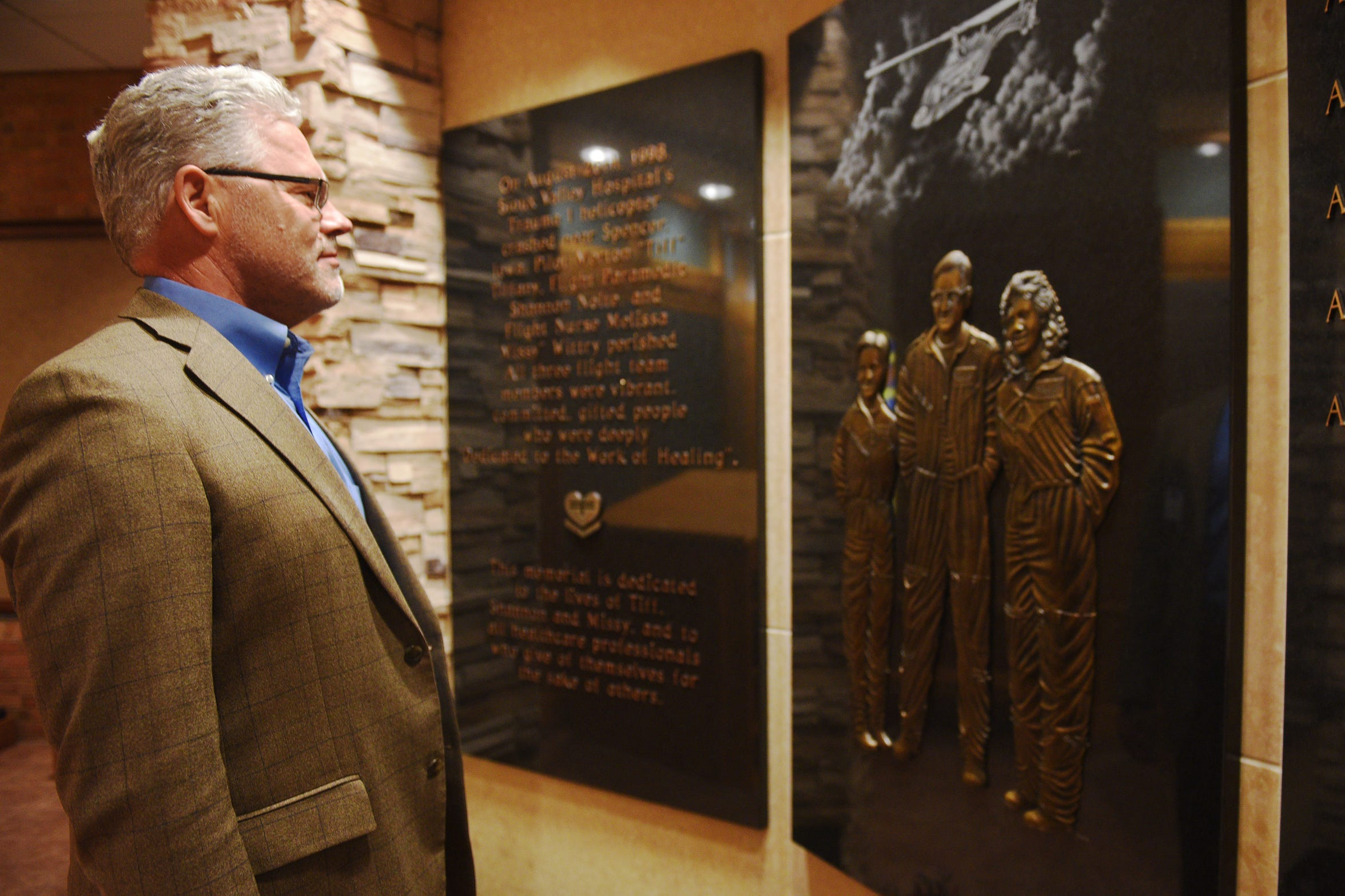 Sanford Health chief administrative officer Randy Bury visits the Sanford Memorial Garden for the 1998 helicopter ambulance crash that killed three crew members. Bury visited the memorial on Aug 22, 2018, 20 years after fatal crash.