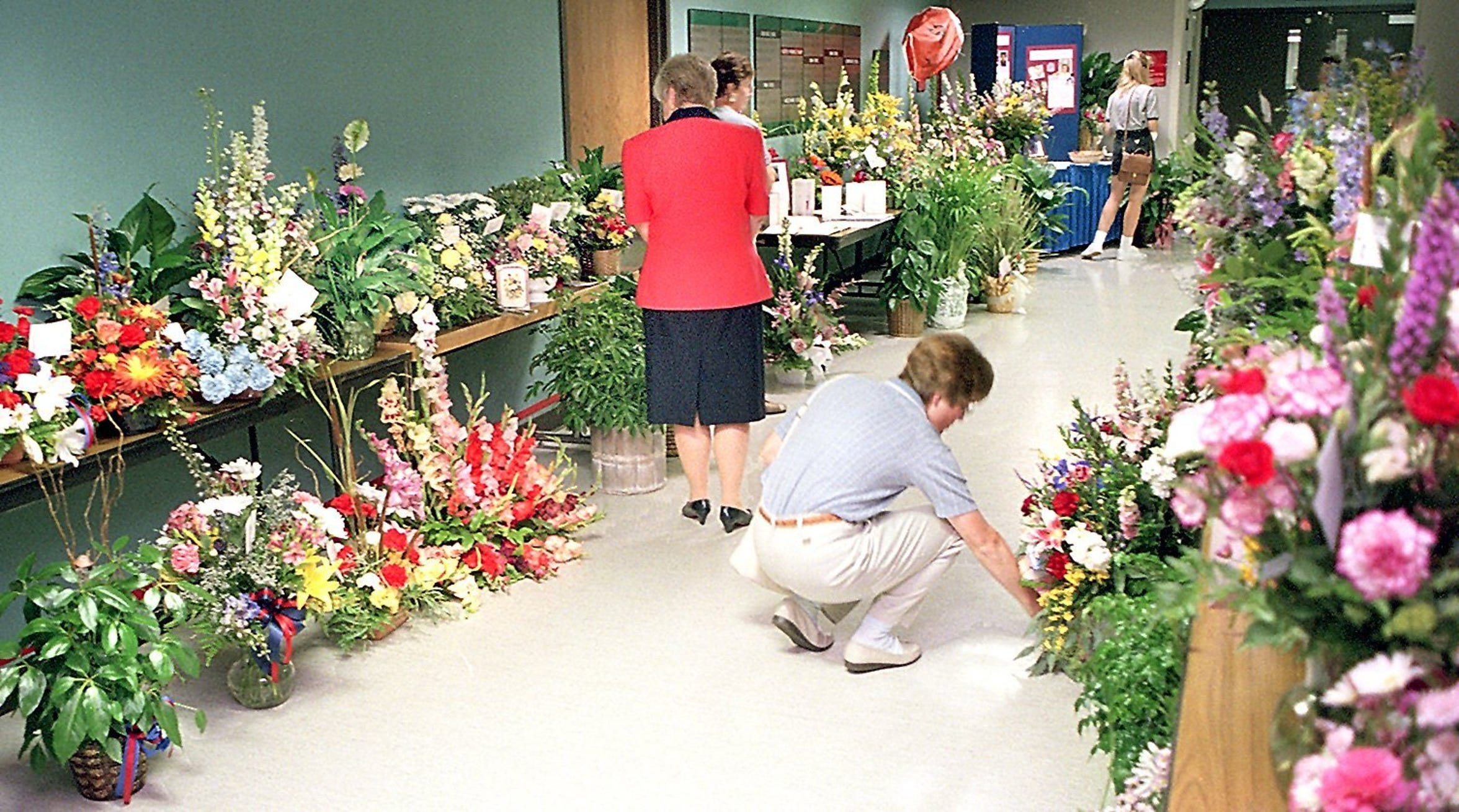 Sioux Valley Hospital employees and visitors read the cards on flowers in the hallway near the emergency room. The flowers were sent from businesses, ambulance groups and former patients after the crash of the Sioux Valley air helicopter in northwestern Iowa.