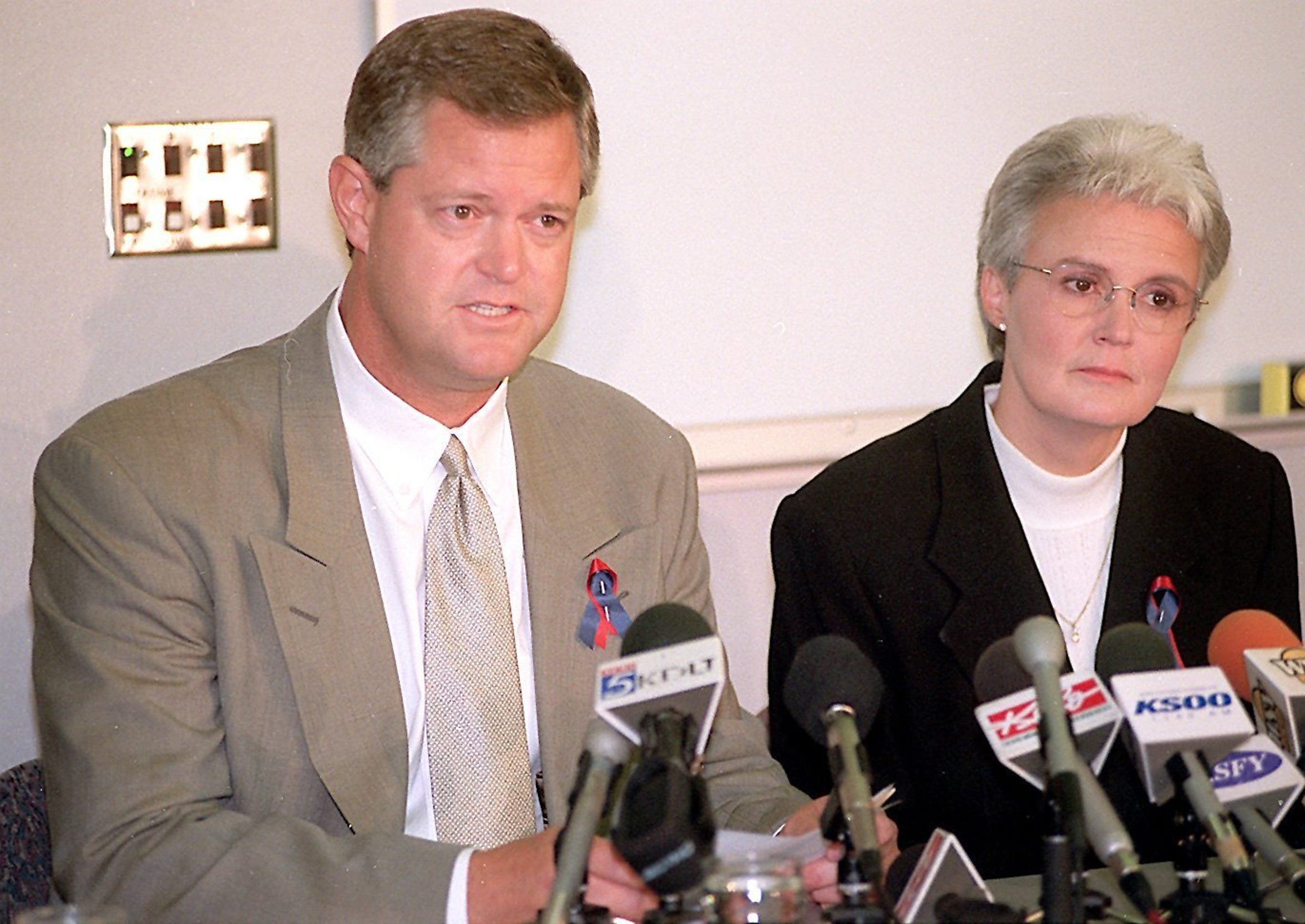 Kelby Krabbenhoft addresses the media along with Sioux Valley executive Becky Nelson following a helicopter crash in 1998 that killed a three-person crew from the hospital.