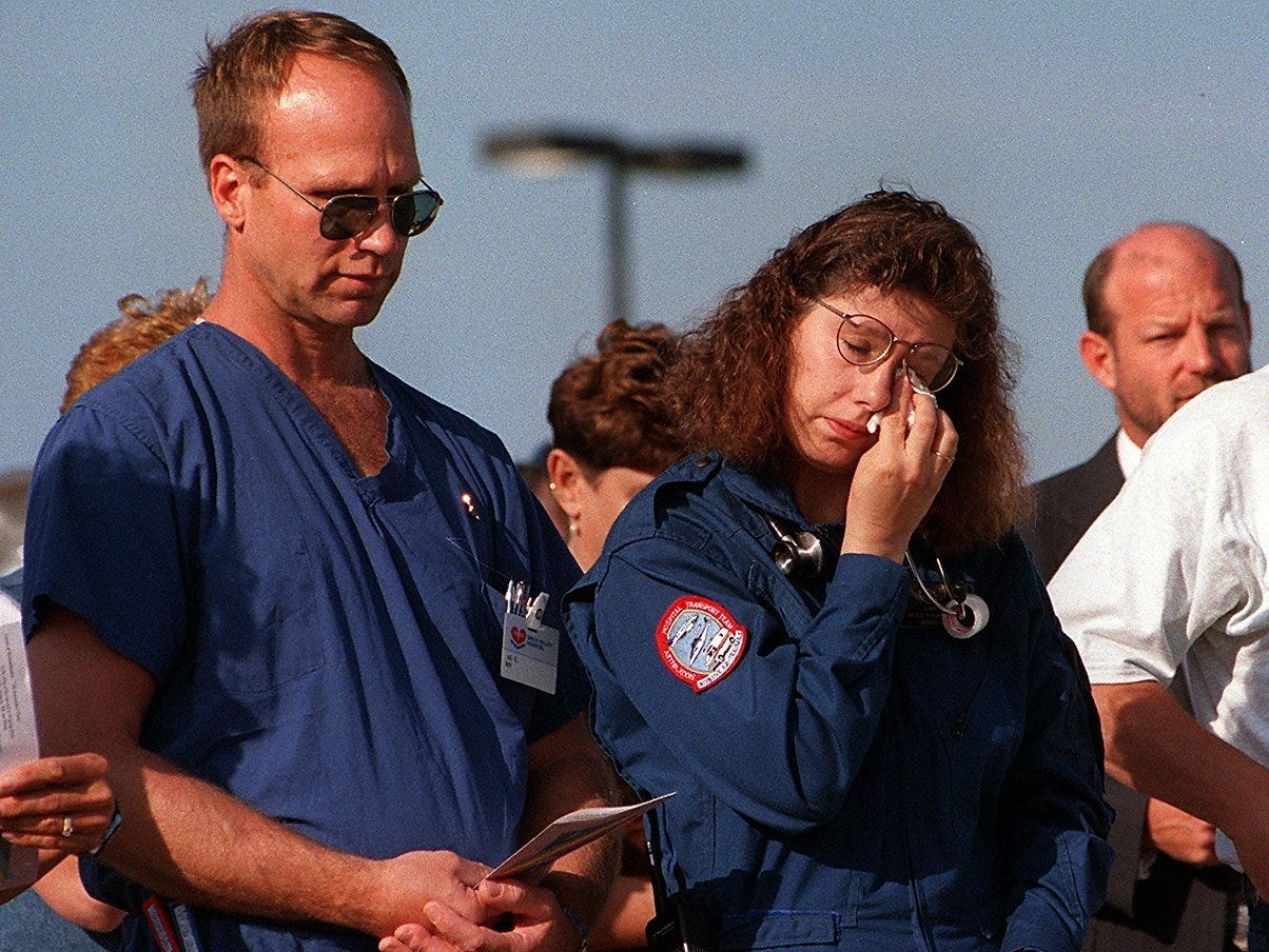 Lisa Lindgren, a flight nurse, wipes away a tear Friday during a memorial service for the crew of three from Sioux Valley Hospital who died last year when their helicopter crashed near Spencer, Iowa. Lindgren worked with the lost crew members.