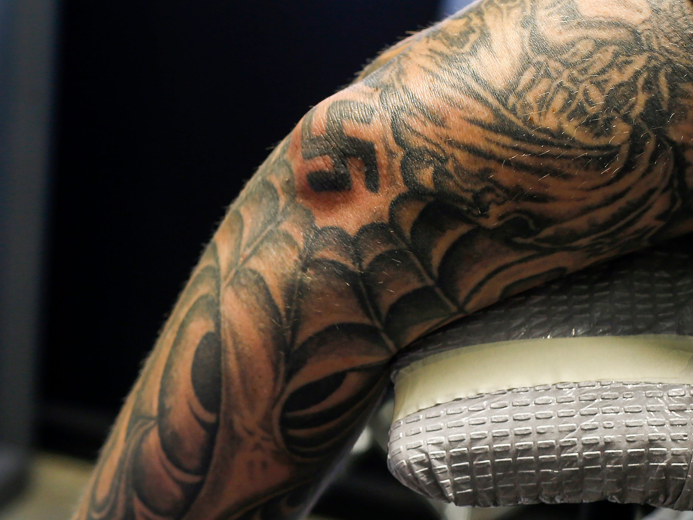 A man who wished not to be identified gets ready to have the swastika tattoo on his arm covered by Justin Fleetwood at Queen City Tattoo Company on Tuesday, Aug. 21, 2018. Fleetwood is offering to cover up people's hate-tattoos at no cost.