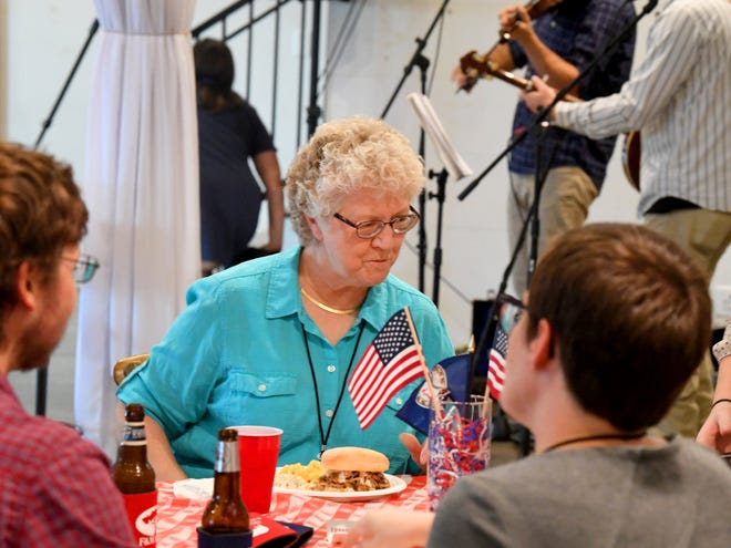 Mayor Carolyn Dull of Staunton talks over dinner while at the Greater Augusta Regional Chamber of Commerce's Pig Pickin' & Politickin' 2018 at Valley Pike Farm Market in Weyers Cave on Tuesday, August 21, 2018.