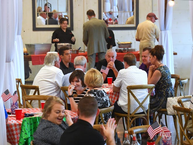 Those in attendance share conversation, talk politics and eat barbecue at the Greater Augusta Regional Chamber of Commerce's Pig Pickin' & Politickin' 2018 at Valley Pike Farm Market in Weyers Cave on Tuesday, August 21, 2018.