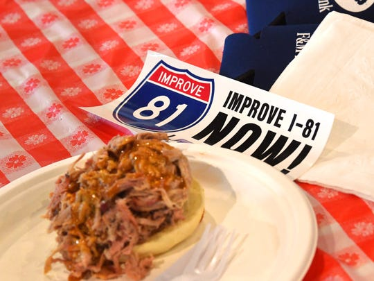 A bumper sticker rests on the table next to a barbecue sandwich at the Greater Augusta Regional Chamber of Commerce's Pig Pickin' & Politickin' 2018 at Valley Pike Farm Market in Weyers Cave on Tuesday, August 21, 2018.