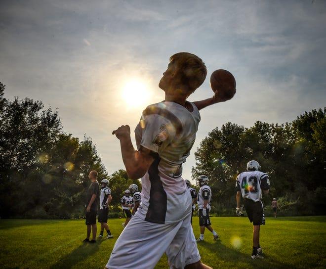 Luke Jansen of Eden Valley-Watkins throws a pass during football practice Tuesday, Aug. 14, in Eden Valley.