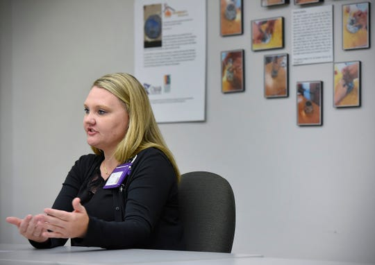 Kimberly Notsch describes Monday, Aug. 20, how she and other On Scene advocates at Anna Marie's Alliance respond to a domestic abuse incidents to help victims as soon as possible.