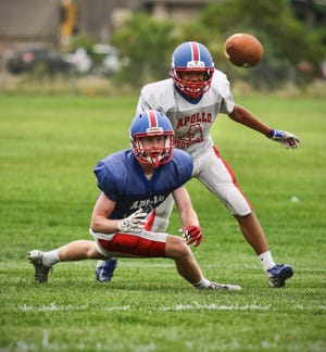 A pair of Eagles jockey for position on this short passing pattern during practice Thursday, Aug. 16, at Apollo High School in St. Cloud.