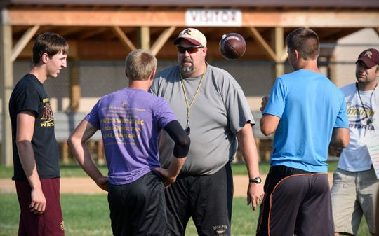 Coach Jamie Morford talks to his players during practice Wednesday, Aug. 15, at Royalton High School.