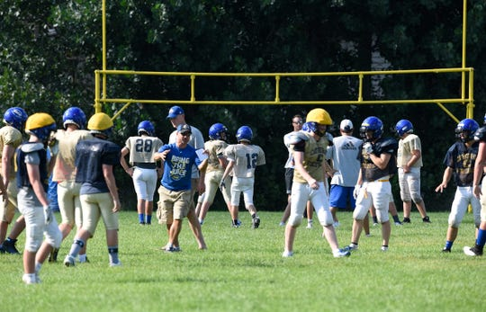 Cathedral players take the field for practice Tuesday, Aug. 21.