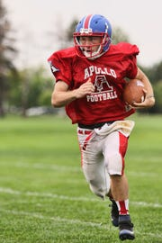 Quarteback Neal Benson turns the play upfield during practice Thursday, Aug. 16, at Apollo High School in St. Cloud.