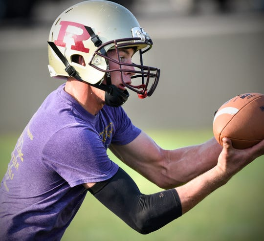 Jackson Held reaches out to catch a pass during practice Wednesday, Aug. 15, at Royalton High School.
