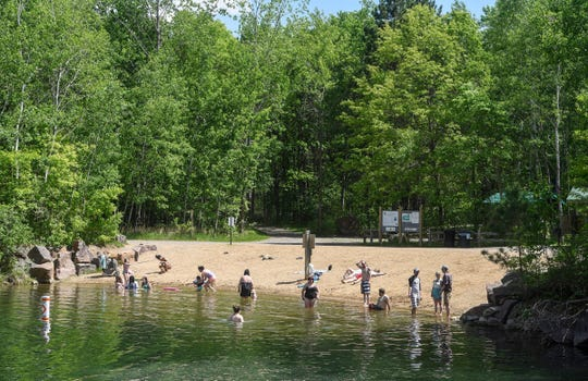 Swimmers enjoy the sandy beach at Quarry 11 at Quarry Park and Nature Preserve in Waite Park in this 2018 file photo.