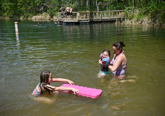 Kora and Paige Voigt enjoy the cool waters of Quarry 11 at the beach with their mother Jodi earlier this summer at Quarry Park and Nature Preserve in Waite Park.