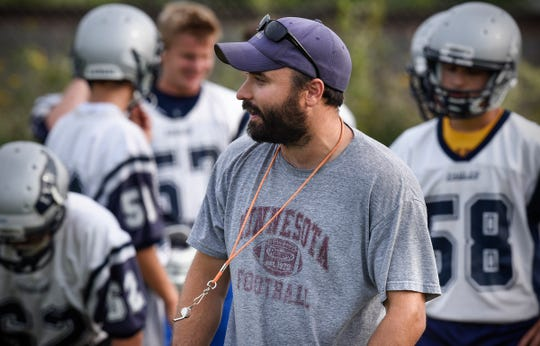 Eden Valley-Watkins first-year head coach Adam Tri talks to his players during practice Tuesday, Aug. 14, in Eden Valley.