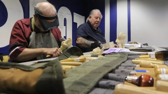 Al Krueger, left and Chuck Petrie carve wooden duck hunters in the event room at the IDEA Center in Stevens Point Monday, August 20, 2018. The two are part of the Wisconsin River Woodcarvers who meet twice a week at the center to carve.