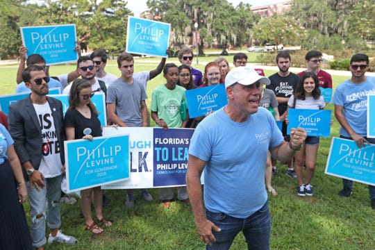 Gubernatorial candidate Philip Levine films a post for social media with campaign staffers and students behind him at Landis Green on FSU's campus Wednesday, Aug. 22, 2018.