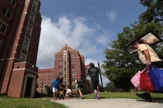 Parents help their children move in to the dorms at FSU on Wednesday, Aug. 22, 2018.