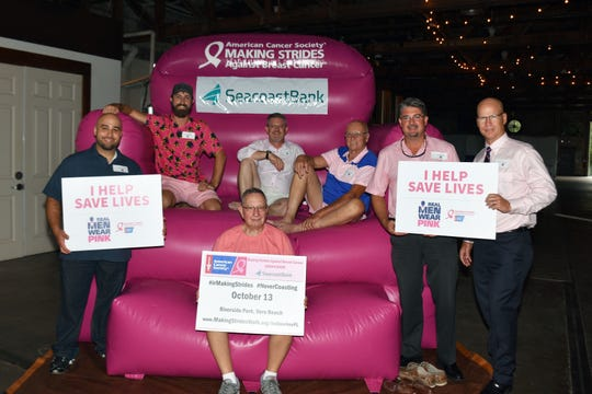The Real Men Wear Pink men who gathered at Walking Tree Brewery recently for a meet andgreet, from left, Andrew Trilla, Alan Dritenbas, Harold Schwartz (on the step), Harry Howle, Ralph Carter, Dr. Nicholas Rutledge, and Dr. Theodore Perry.