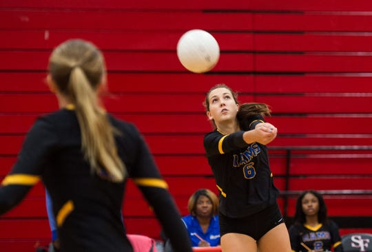 John Carroll Catholic's Hannah Rankin keeps the ball in play during a volley with South Fork during the second game of the high school volleyball match Tuesday, Aug. 21, 2018, at South Fork High School in Tropical Farms.
