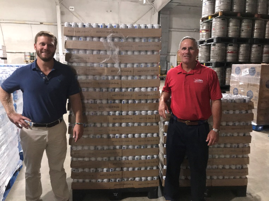 Southern Eagle Distributing's Philip Busch, left, and Paul Trabulsy with a pallet of water.