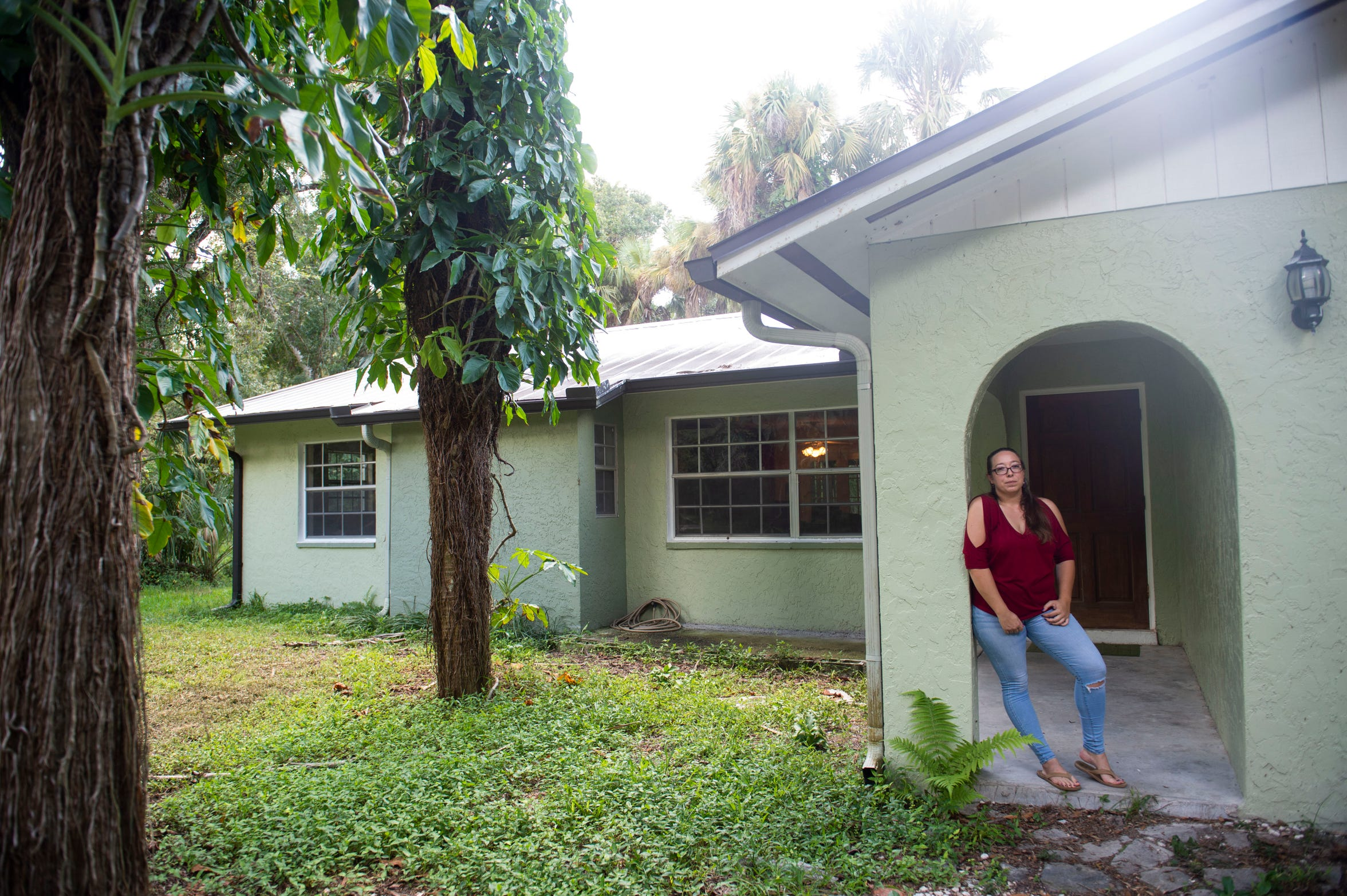 "Following Hurricane Irma in Sept. 2017, the interior of Courtney Crowley's home was covered in 11 inches of water, causing $90,000 in damage, excluding personal belongings. When Crowley and her husband were able to make their way back to their property several days after Irma's landfall, they had to jimmy a window open to enter the house, then kick the front door open. ""You could see water still on the floor. The couches were all soaked. All of my mattresses were ruined, most of my clothes, almost all of my furniture, I mean everything. We threw out everything,"" Crowley said. The Crowleys moved back into their home in May and are slowly collecting new possessions."